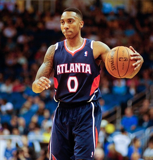 Dec 29, 2013; Orlando, FL, USA; Atlanta Hawks point guard Jeff Teague (0) holds the ball as the Atlanta Hawks face the Orlando Magic at Amway Center. Mandatory Credit: David Manning-USA TODAY Sports