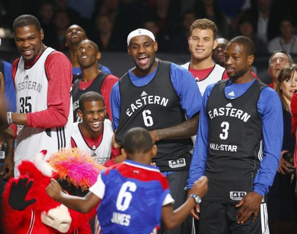 (L-R) NBA All-Stars Kevin Durant (35) of Oklahoma City Thunder, Chris Paul of Los Angeles Clippers, LeBron James (6) of Miami Heat, Blake Griffin of the Clippers and Dwyane Wade of Miami Heat watch a young fan during a dance contest during practice for the NBA All-Star basketball game in Houston, Texas February 16, 2013.