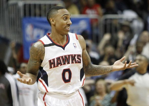 Apr 24, 2014; Atlanta, GA, USA; Atlanta Hawks guard Jeff Teague (0) shows emotion after making a shot against the Indiana Pacers in the fourth quarter in game three of the first round of the 2014 NBA Playoffs at Philips Arena. The Hawks defeated the Pacers 98-85. Mandatory Credit: Brett Davis-USA TODAY Sports