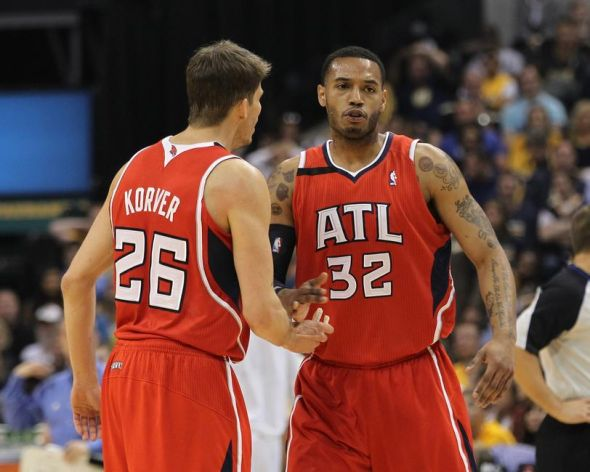 Apr 28, 2014; Indianapolis, IN, USA; Atlanta Hawks guard Kyle Korver (26) and forward Mike Scott (32) react during the second quarter in game five of the first round of the 2014 NBA Playoffs against the Indiana Pacers at Bankers Life Fieldhouse. Mandatory Credit: Pat Lovell-USA TODAY Sports