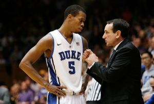 Nov 19, 2013; Durham, NC, USA; Duke Blue Devils head coach Mike Krzyzewski talks to forward Rodney Hood (5) on the sidelines against the East Carolina Pirates at Cameron Indoor Stadium. Mandatory Credit: Mark Dolejs-USA TODAY Sports
