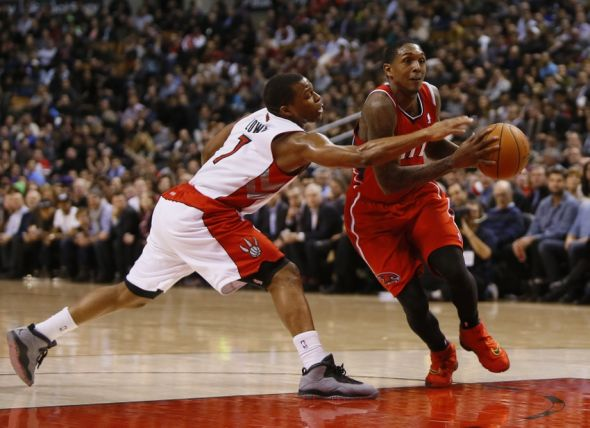 Feb 12, 2014; Toronto, Ontario, CAN; Atlanta Hawks guard Louis Williams (3) tries to get by Toronto Raptors guard Kyle Lowry (7) at the Air Canada Centre. Toronto defeated Atlanta 104-83. Mandatory Credit: John E. Sokolowski-USA TODAY Sports