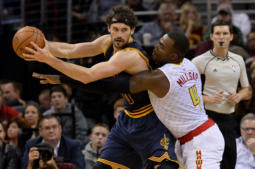 Nov 21, 2015; Cleveland, OH, USA; Atlanta Hawks forward Paul Millsap (4) defends against Cleveland Cavaliers forward Kevin Love (0) during the fourth quarter at Quicken Loans Arena. The Cavs won 109-97. Mandatory Credit: Ken Blaze-USA TODAY Sports