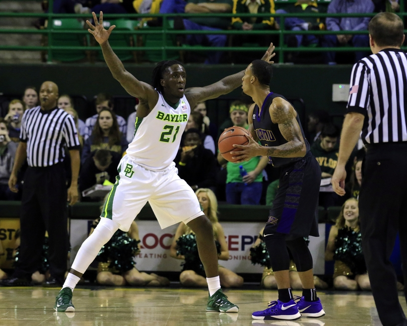 Dec 2, 2015; Waco, TX, USA; Baylor Bears forward Taurean Prince (21) guards Prairie View A&M Panthers guard Jayrn Johnson (1) during the first half at Ferrell Center. Mandatory Credit: Ray Carlin-USA TODAY Sports
