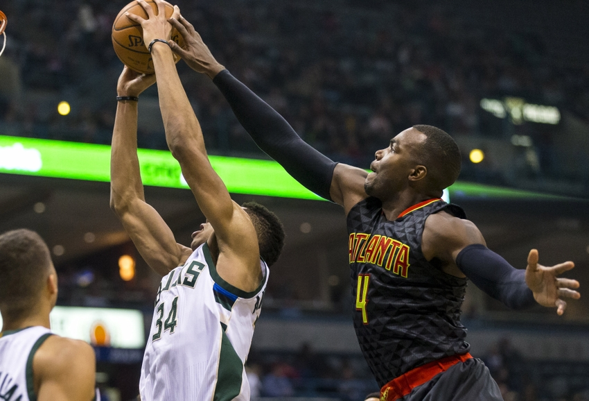 9058818-paul-millsap-giannis-antetokounmpo-nba-atlanta-hawks-milwaukee-bucks