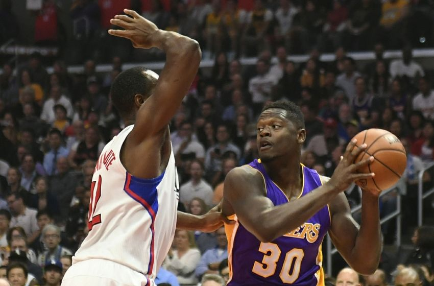 Apr 5, 2016; Los Angeles, CA, USA; Los Angeles Clippers forward Luc Richard Mbah a Moute (12) ) defends against Los Angeles Lakers forward Julius Randle (30) during the first half at Staples Center. Mandatory Credit: Richard Mackson-USA TODAY Sports