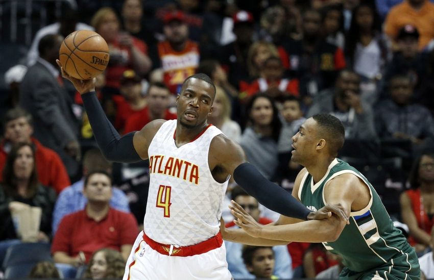 9211135-jabari-parker-paul-millsap-nba-milwaukee-bucks-atlanta-hawks