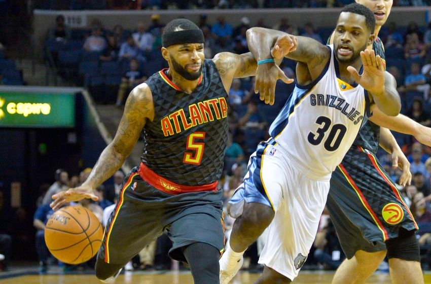 Oct 6, 2016; Memphis, TN, USA; Atlanta Hawks guard Malcolm Delaney (5) dribbles the ball as Memphis Grizzlies guard <a rel=