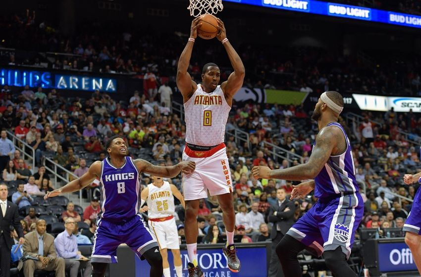Oct 31, 2016; Atlanta, GA, USA; Atlanta Hawks center Dwight Howard (8) controls a rebound between Sacramento Kings forward Rudy Gay (8) and center DeMarcus Cousins (15) during the second half at Philips Arena. The Hawks defeated the Kings 106-95. Mandatory Credit: Dale Zanine-USA TODAY Sports