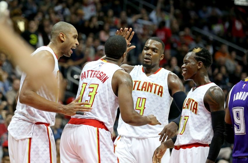 Nov 18, 2015; Atlanta, GA, USA; Atlanta Hawks guard Lamar Patterson (13) celebrates a play with center Al Horford (15, left), forward Paul Millsap (4), and guard Dennis Schroder (17) in the fourth quarter of their game against the Sacramento Kings at Philips Arena. The Hawks won 103-97. Mandatory Credit: Jason Getz-USA TODAY Sports