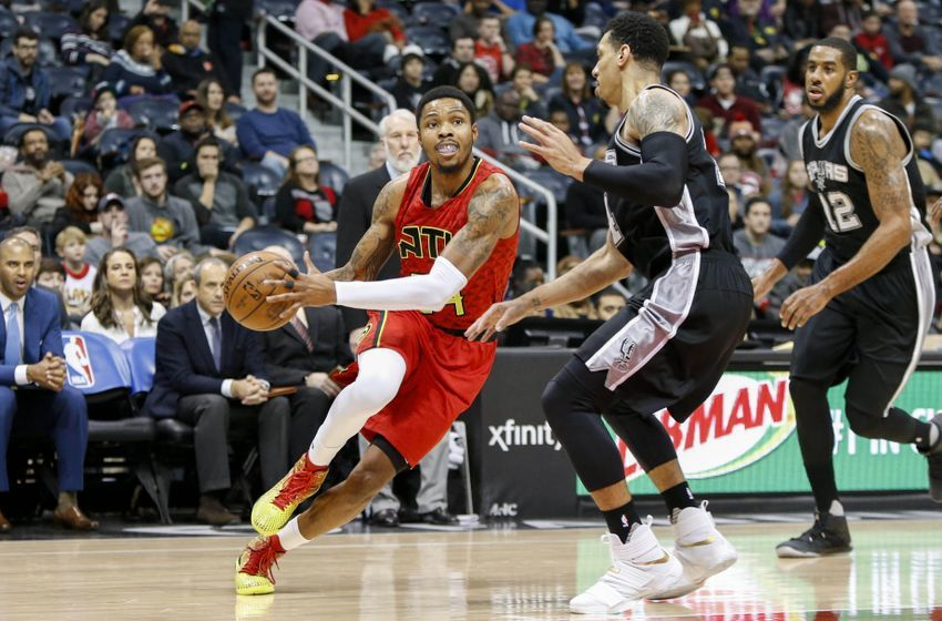 Jan 1, 2017; Atlanta, GA, USA; Atlanta Hawks forward Kent Bazemore (24) drives to the basket against the San Antonio Spurs in the first quarter at Philips Arena. Mandatory Credit: Brett Davis-USA TODAY Sports