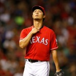 Sep 9, 2013; Arlington, TX, USA; Texas Rangers starting pitcher Yu Darvish (11) walks off the field in the sixth inning of the game against the Pittsburgh Pirates at Rangers Ballpark in Arlington. Mandatory Credit: Tim Heitman-USA TODAY Sports