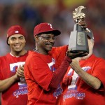 Oct 15, 2011; Arlington, TX, USA; Texas Rangers manager Ron Washington hoists the American League championship trophy after his team defeated the Detroit Tigers 15-5 in game six of the 2011 ALCS at Rangers Ballpark. Mandatory Credit: Matthew Emmons-USA TODAY Sports