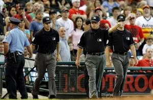 June 2, 2012; Houston, TX, USA; Third base umpire Jim Joyce upholds a call on the field during a replay during a game between the Houston Astros and Cincinnati Reds in the third inning at Minute Maid Park. Mandatory Credit: Brett Davis-USA TODAY Sports
