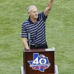 August 11, 2012; Arlington, TX, USA; Texas Rangers radio broadcaster Eric Nadel waves to fans after being inducted into the Texas Rangers Hall of Fame before the game against the Detroit Tigers at Rangers Ballpark in Arlington. Mandatory Credit: Jim Cowsert-USA TODAY Sports