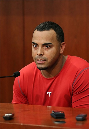 Aug 30, 2013; Arlington, TX, USA; Texas Rangers right fielder Nelson Cruz (17) makes a statement to the media apologizing to fans for being suspended before the game against the Minnesota Twins at Rangers Ballpark in Arlington. Mandatory Credit: Kevin Jairaj-USA TODAY Sports