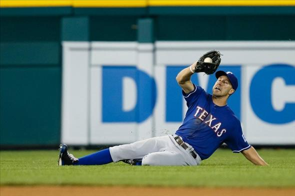 July 13, 2013; Detroit, MI, USA; Texas Rangers left fielder David Murphy (7) makes a sliding catch of a ball hit by Detroit Tigers designated hitter Victor Martinez (not pictured) in the eighth inning at Comerica Park. Mandatory Credit: Rick Osentoski-USA TODAY Sports