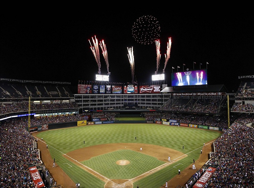 Aug 16, 2013; Arlington, TX, USA; Fireworks illuminate the sky over the Texas Rangers Ballpark between innings of the game against the Seattle Mariners. The Mariners won 3-1. Mandatory Credit: Jim Cowsert-USA TODAY Sports