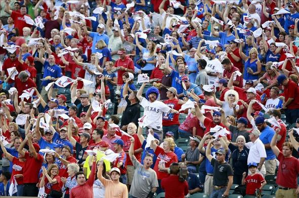 Sep 30, 2013; Arlington, TX, USA; Texas Rangers fans cheer during the first inning against the Tampa Bay Rays at Rangers Ballpark at Arlington. Mandatory Credit: Tim Heitman-USA TODAY Sports