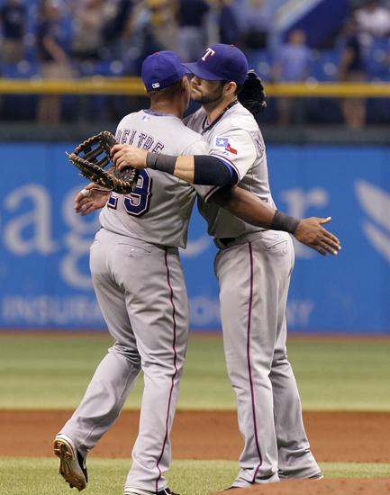 Adrian Beltre and Mitch Moreland celebrate a victory.