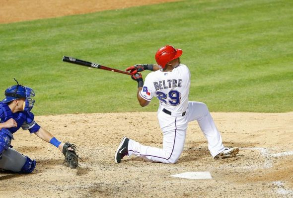 Adrian Beltre hits a home run during the 2013 season.