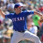 Mar 15, 2014; Phoenix, AZ, USA; Texas Rangers starting pitcher Colby Lewis (48) pitches in the first inning against the Oakland Athletics at Phoenix Municipal Stadium. Mandatory Credit: Joe Camporeale-USA TODAY Sports