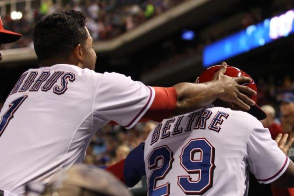 Adrian Beltre and Elvis Andrus having fun in the dugout.