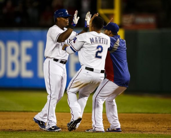 Adrian Beltre and Leonys Martin celebrate a game winning hit.