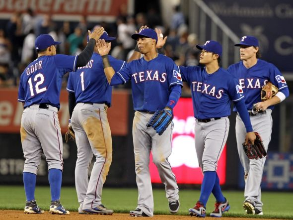 Jul 21, 2014; Bronx, NY, USA; The Texas Rangers celebrate their win against the New York Yankees at Yankee Stadium. The Rangers defeated the Yankees 4-2. Mandatory Credit: Adam Hunger-USA TODAY Sports