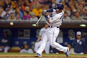 Jun 18, 2014; San Diego, CA, USA; San Diego Padres third baseman Alexi Amarista (5) singles during the sixth inning against the Seattle Mariners at Petco Park. Mandatory Credit: Jake Roth-USA TODAY Sports