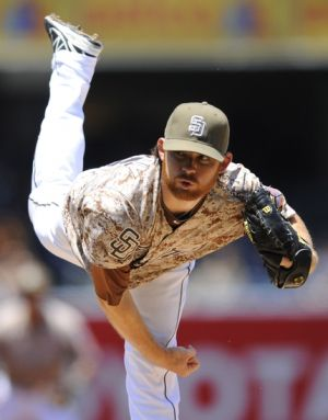 May 25, 2014; San Diego, CA, USA; San Diego Padres starting pitcher Ian Kennedy (22) throws during the first inning against the Chicago Cubs at Petco Park. Mandatory Credit: Christopher Hanewinckel-USA TODAY Sports