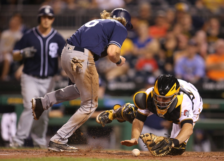 Aug 10, 2016; Pittsburgh, PA, USA; San Diego Padres center fielder Travis Jankowski (C) steals home plate as Pittsburgh Pirates catcher Eric Fryer (24) drops the ball during the eighth inning at PNC Park. Mandatory Credit: Charles LeClaire-USA TODAY Sports