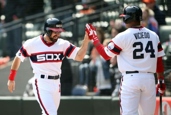Apr 27, 2014; Chicago, IL, USA; Chicago White Sox center fielder Adam Eaton (1) celebrates with right fielder Dayan Viciedo (24) after scoring a run against the Tampa Bay Rays during the sixth inning at U.S Cellular Field. Mandatory Credit: Jerry Lai-USA TODAY Sports
