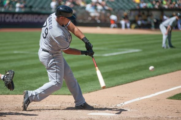 May 14, 2014; Oakland, CA, USA; Chicago White Sox designated hitter Jose Abreu (79) hits a three run home run against the Oakland Athletics during the eighth inning at O.co Coliseum. The Chicago White Sox defeated the Oakland Athletics 4-2. Mandatory Credit: Ed Szczepanski-USA TODAY Sports