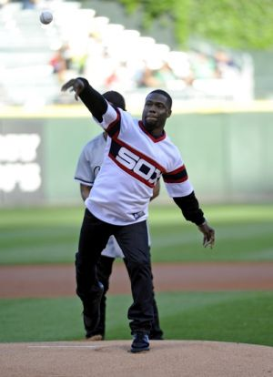 Jun 13, 2014; Chicago, IL, USA; Actor comedian Kevin Hart throws out the first pitch before the game between the Chicago White Sox and the Kansas City Royals at U.S Cellular Field. Mandatory Credit: David Banks-USA TODAY Sports