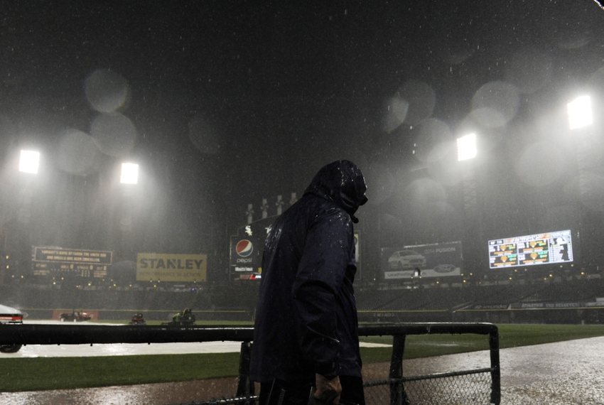Jun 30, 2014; Chicago, IL, USA; A worker leaves the field area after