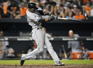Jun 24, 2014; Baltimore, MD, USA; Chicago White Sox shortstop Alexei Ramirez (10) singles in the eighth inning against the Baltimore Orioles at Oriole Park at Camden Yards. The White Sox defeated the Orioles 4-2. Mandatory Credit: Joy R. Absalon-USA TODAY Sports