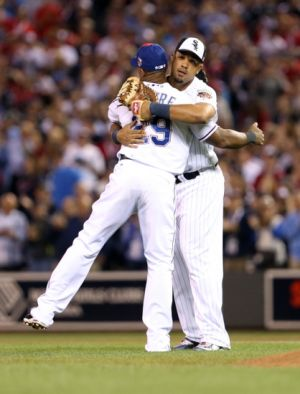 Jul 15, 2014; Minneapolis, MN, USA; American League infielder Adrian Beltre (29) of the Texas Rangers hugs infielder Jose Abreu (right) of the Chicago White Sox after the 2014 MLB All Star Game at Target Field. Mandatory Credit: Jesse Johnson-USA TODAY Sports