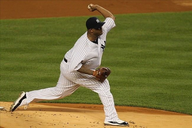 Sep 30, 2011; Bronx, NY, USA; New York Yankees starting pitcher CC Sabathia (52) delivers a pitch during the first inning of game one of the 2011 ALDS against the Detroit Tigers at Yankee Stadium. Mandatory Credit: Anthony Gruppuso-US PRESSWIRE