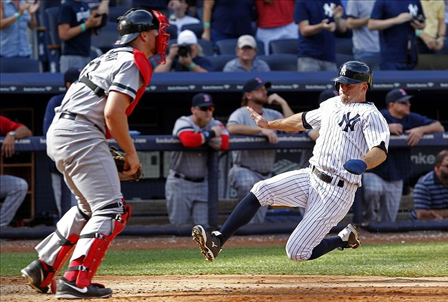Sep 7, 2013; Bronx, NY, USA; New York Yankees center fielder Brett Gardner (11) slides into home plate of New York Yankees vs. Boston Red Sox baseball game at Yankee Stadium. Mandatory Credit: Noah K. Murray-USA TODAY Sports.