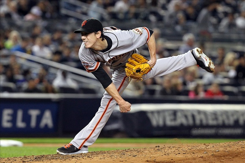 Sep 20, 2013; Bronx, NY, USA; San Francisco Giants starting pitcher Tim Lincecum (55) pitches against the New York Yankees during the fourth inning of a game at Yankee Stadium. Mandatory Credit: Brad Penner-USA TODAY Sports