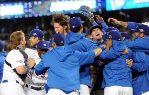 Oct 7, 2013; Los Angeles, CA, USA; Los Angeles Dodgers starting pitcher Clayton Kershaw (22) and team celebrate defeating the Atlanta Braves 3-2 in game four of the National League divisional series at Dodger Stadium. Dodgers won 3-2. Mandatory Credit: Jayne Kamin-Oncea-USA TODAY Sports
