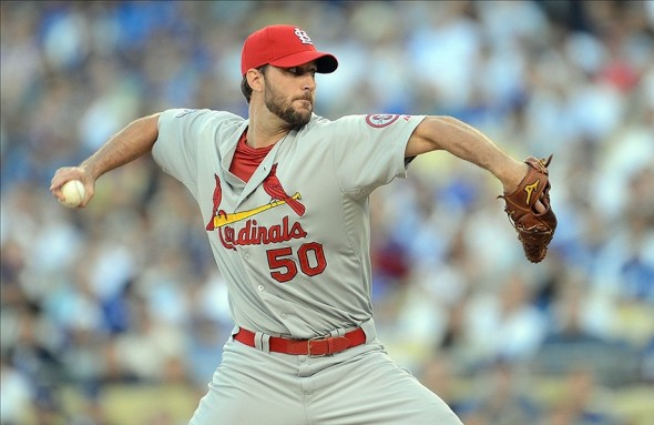 October 14, 2013; Los Angeles, CA, USA; St. Louis Cardinals starting pitcher Adam Wainwright (50) pitches the first inning against the Los Angeles Dodgers in game three of the National League Championship Series baseball game at Dodger Stadium. Mandatory Credit: Jayne Kamin-Oncea-USA TODAY Sports