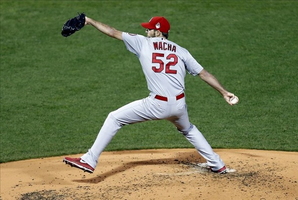 Oct 24, 2013; Boston, MA, USA; St. Louis Cardinals starting pitcher Michael Wacha (52) throws against the Boston Red Sox during the third inning of game two of the MLB baseball World Series at Fenway Park. Mandatory Credit: Mark L. Baer-USA TODAY Sports
