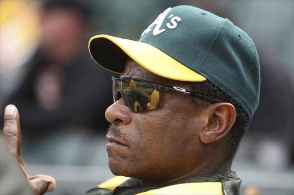April 25, 2012; Oakland, CA, USA; Former Oakland Athletics player Rickey Henderson follows the action against the Chicago White Sox during the tenth inning at O.co Coliseum. The Oakland Athletics defeated the Chicago White Sox 5-4 in 14 innings. Mandatory Credit: Kelley L Cox-USA TODAY Sports