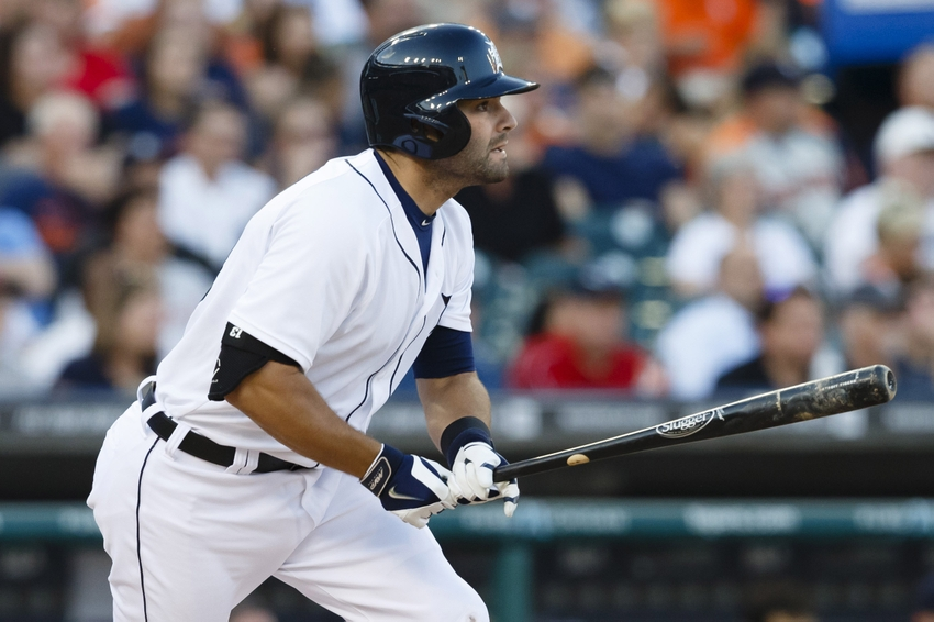 Jun 6, 2014; Detroit, MI, USA; Detroit Tigers catcher Alex Avila (13) hits a single in the fourth inning against the Boston Red Sox at Comerica Park. Mandatory Credit: Rick Osentoski-USA TODAY Sports