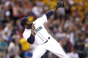 Aug 5, 2014; Seattle, WA, USA; Seattle Mariners pitcher Fernando Rodney (56) celebrates on the field after the final out defeating the Atlanta Braves 4-2 at Safeco Field. Mandatory Credit: Joe Nicholson-USA TODAY Sports