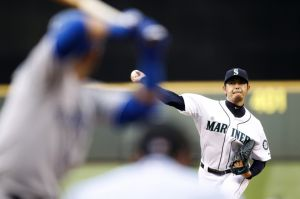 Aug 13, 2014; Seattle, WA, USA; Seattle Mariners pitcher Hisashi Iwakuma (18) throws against the Toronto Blue Jays during the first inning at Safeco Field. (Joe Nicholson-USA TODAY Sports)