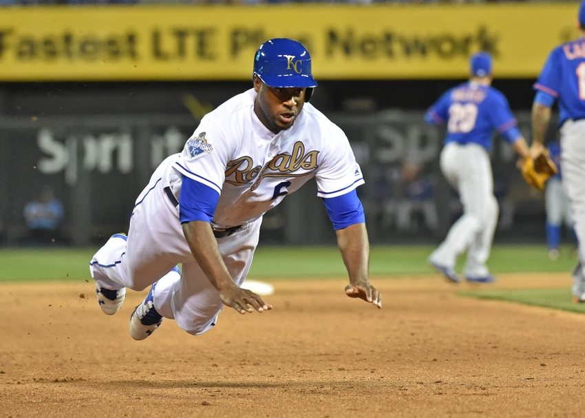 Apr 3, 2016; Kansas City, MO, USA; Kansas City Royals center fielder Lorenzo Cain (6) dives into third base, after a single from Eric Hosmer against the New York Mets during the fourth inning at Kauffman Stadium. Mandatory Credit: Peter G. Aiken-USA TODAY Sports