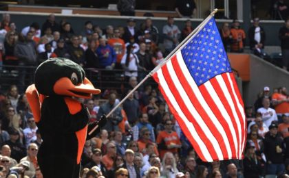 May 15, 2016; Baltimore, MD, USA; Baltimore Orioles mascot hold an American flag during the singing of God Bless American during the seventh inning against the Detroit Tigers at Oriole Park at Camden Yards. Detroit Tigers defeated Baltimore Orioles 6-5. Mandatory Credit: Tommy Gilligan-USA TODAY Sports